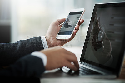 Buy stock photo Closeup shot of an unrecognizable businessman using a cellphone and laptop in an office
