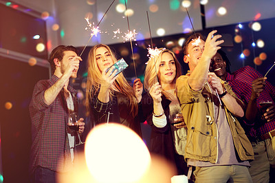 Buy stock photo Cropped shot of a group of friends having fun at a nightclub