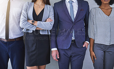 Buy stock photo Closeup shot of a group of unrecognizable businesspeople standing in line against a grey background