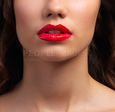 Buy stock photo Cropped shot of a beautiful young woman with gorgeous red lips