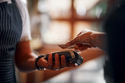 Buy stock photo Closeup of an unrecognizable person making a payment to a barman through use of a credit card inside a beer brewery during the day