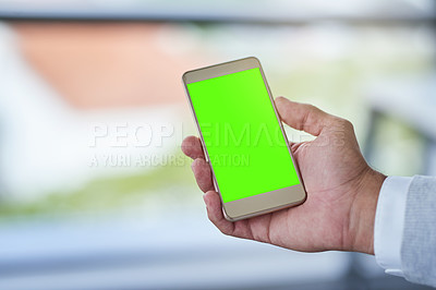 Buy stock photo Cropped shot of a businessman using a mobile phone with a green screen in a modern office