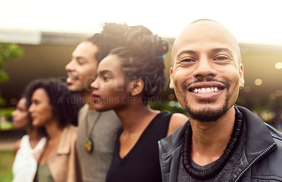 Buy stock photo Cropped shot of a group of friends standing in a row in a public park