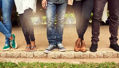 Buy stock photo Cropped shot of a group of unrecognizable people standing in a row in a public park