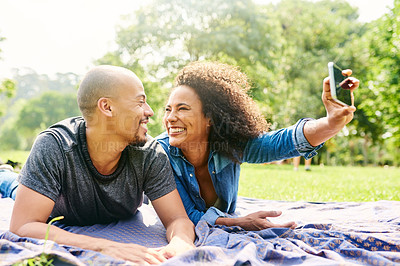 Buy stock photo Cropped shot of a young beautiful couple spending the day in a public park