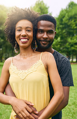 Buy stock photo Cropped portrait of an affectionate young couple spending some time together in the park