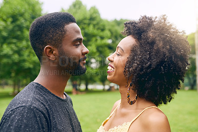 Buy stock photo Cropped shot of an affectionate young couple spending some time together in the park