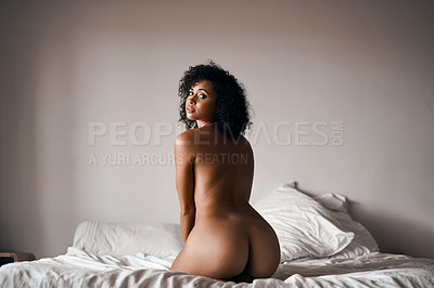 Buy stock photo Rearview shot of a beautiful young woman sitting on her bed in the nude