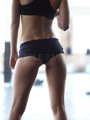 Buy stock photo Rearview shot of an unrecognizable woman in the gym