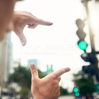Buy stock photo Closeup shot of an unrecognizable businessman framing a city background with his fingers