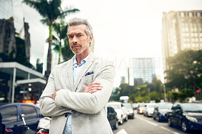 Buy stock photo Portrait of a mature businessman standing in the city