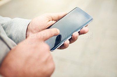 Buy stock photo Closeup shot of an unrecognizable businessman using a cellphone outdoors