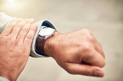 Buy stock photo Closeup shot of an unrecognizable businessman checking the time on his wrist watch