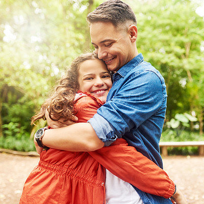 Buy stock photo Cropped portrait of an adorable young girl and her father embracing in the park