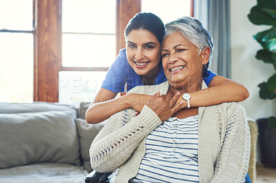 Buy stock photo Portrait of a cheerful young female nurse holding a elderly patient in a wheelchair as support inside at home during the day