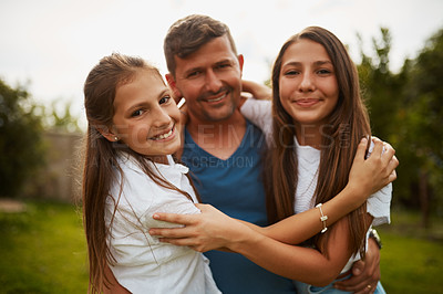 Buy stock photo Cropped shot of a handsome man and his two young daughters standing outside