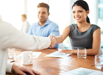 Buy stock photo Shot of a young businesswoman shaking hands with a colleague during a conference in a modern office
