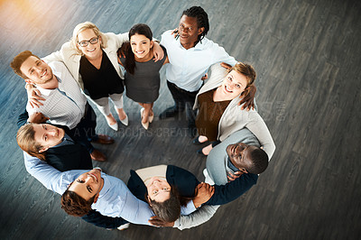 Buy stock photo High angle portrait of a group of young businesspeople huddled together in solidarity