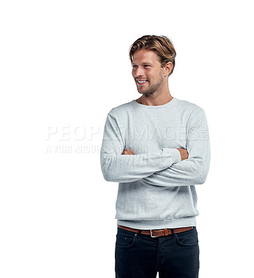 Buy stock photo Studio shot of a handsome young man standing with his arms folded against a white background