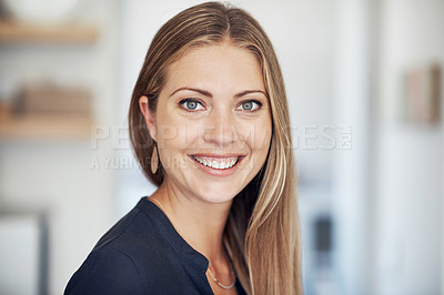 Buy stock photo Shot of an attractive and happy young woman at home