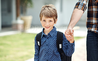 Buy stock photo Portrait of an adorable little boy wearing a backpack while walking with his father outdoors