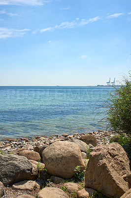 Buy stock photo A calm summer day at the beach and shoreA calm summer day at the beach and shoreA calm summer day at the beach and shoreA calm summer day at the beach and shoreA calm summer day at the beach and shore
