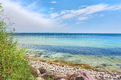 Buy stock photo A calm summer day at the beach and shoreA calm summer day at the beach and shoreA calm summer day at the beach and shoreA calm summer day at the beach and shore
