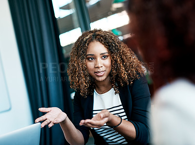 Buy stock photo Cropped shot of an attractive young businesswoman talking to a colleague during a meeting in the boardroom