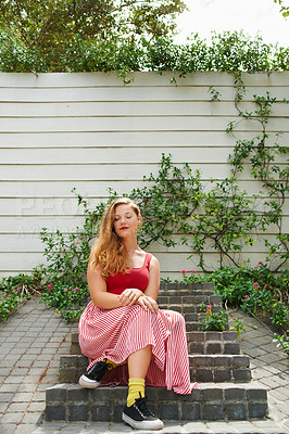 Buy stock photo Shot of a beautiful young woman sitting on steps outside