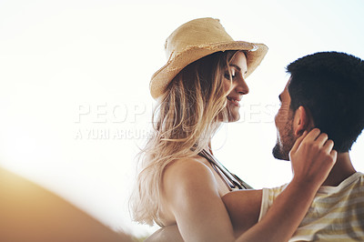 Buy stock photo Cropped shot of an affectionate young couple sharing an intimate moment outside on their balcony