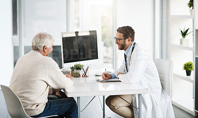 Buy stock photo Cropped shot of a confident young male doctor consulting a senior patient inside of the doctor's office