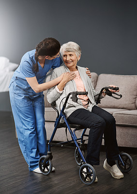 Buy stock photo Full length shot of a young female nurse talking to a wheelchair-bound senior female patient