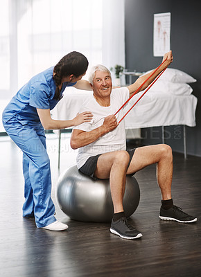 Buy stock photo Full length shot of a young female physiotherapist working with a senior male patient