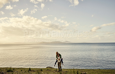 Buy stock photo Shot of an attractive young couple spending the day in nature