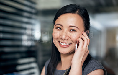 Buy stock photo Portrait of a young businesswoman using a mobile phone in a modern office