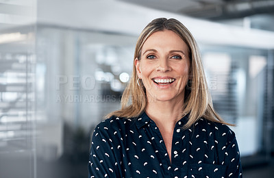 Buy stock photo Portrait of a confident mature businesswoman working in a modern office