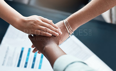 Buy stock photo Cropped shot of a team of businesspeople joining their hands in solidarity