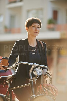 Buy stock photo Cropped shot of an attractive young businesswoman on her way to work