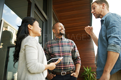 Buy stock photo Cropped shot of three businesspeople meeting on the balcony of their office
