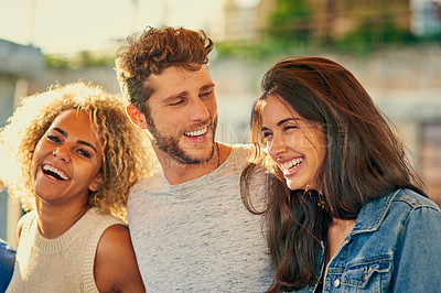 Buy stock photo Cropped shot of young friends spending the day outside