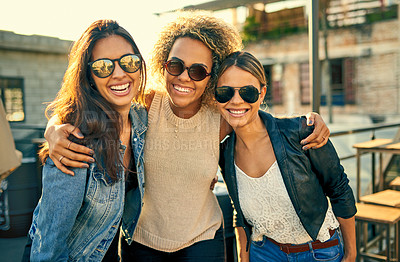 Buy stock photo Cropped shot of three female best friends spending the day outside on a rooftop