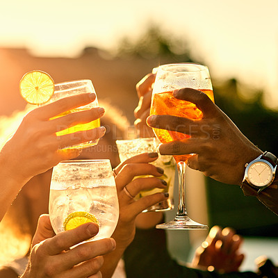 Buy stock photo Closeup shot of a group of unrecognizable friends having a toast and spending the day outside on a rooftop