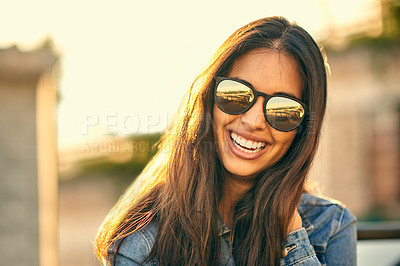 Buy stock photo Portrait of an attractive young woman spending the day outside on a rooftop