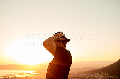 Buy stock photo Cropped shot of an unrecognizable young man taking in the views during his hike in the mountains