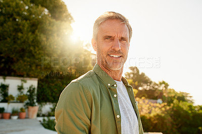 Buy stock photo Cropped portrait of a handsome mature man standing outdoors