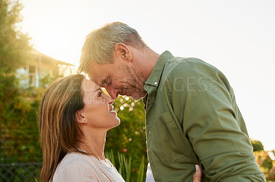 Buy stock photo Cropped shot of an affectionate mature couple standing face to face outside