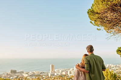 Buy stock photo Rearview shot of an unrecognizable mature couple taking in the sights outdoors