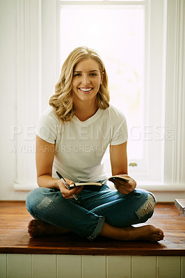 Buy stock photo Portrait of an attractive young woman writing in a book at home