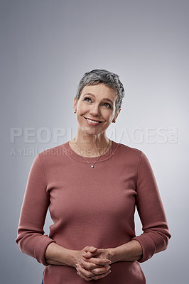 Buy stock photo Studio shot of a confident mature woman posing against a gray background