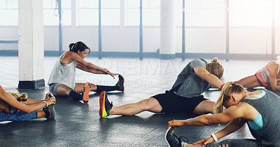 Buy stock photo Shot of a group of young people working out together in a gym